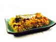 Paella con verduras y sardinas