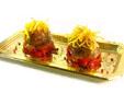 Medallones de solomillo de cerdo con pimiento piquillo y patata rallada