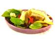 Ensalada de pimientos y solomillo con nachos y vinagreta de queso crema